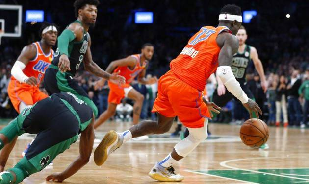 Oklahoma City Thunder's Dennis Schroder (17) steals the ball from Boston Celtics' Kemba Walker (8) during the second half of an NBA basketball...