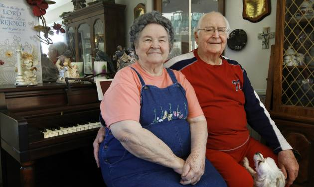 Sitting beside each other on their piano bench in their home. The Gadberrys are a septuagenarian gospel singing couple who have renovated their home to allow them to live there safely — looking for
