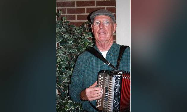Irish born-Oklahoman Philip Duffy plays his button accordion.  STAFF PHOTO BY DAVID CHRISTOPHER