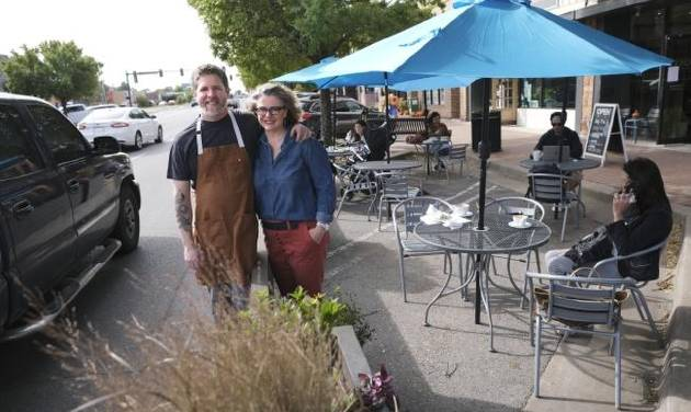Robert and Lori Black stand outside the streatery they built adjacent to their coffee shop, Cafe Evoke, in downtown Edmond. [Doug Hoke/The...