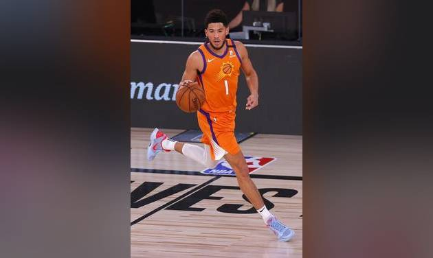 August 6, 2020; Lake Buena Vista, Florida, USA; Devin Booker #1 of the Phoenix Suns moves the ball down court against the Indiana Pacers at Visa...
