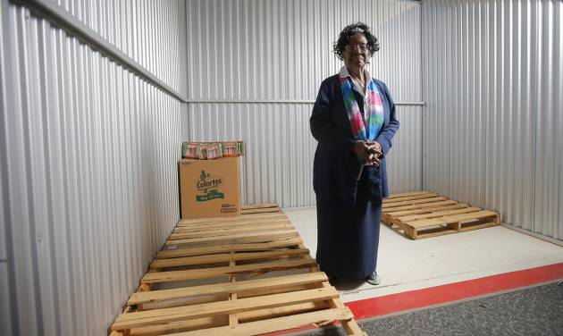 Mable Stoss, founder and director of the Free Food Pantry and Educational Center, stands inside an empty storage unit. [PHOTO BY BRYAN TERRY, THE OKLAHOMAN]