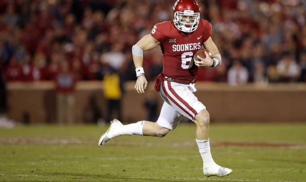 Oklahoma\'s Baker Mayfield (6) scrambles during a college football game between the Oklahoma...
