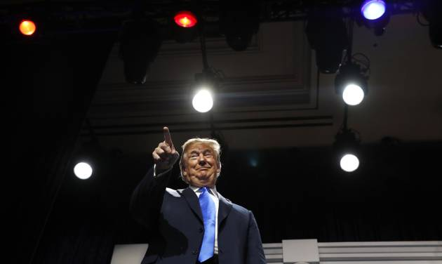 President Donald Trump smiles and points at Republican mega-donor Sheldon Adelson, as Trump arrives to speak at the Republican Jewish Coalition's...