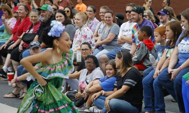 A crowd watches dancers from Everything Goes Dance Studio perform during the Plaza District Festival in Oklahoma City in 2017. [Bryan Terry/The...