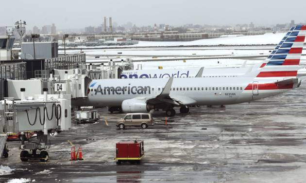 American Airlines announces pay raises, and investors balk