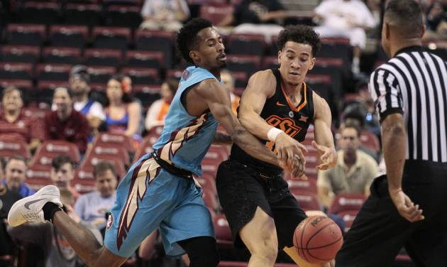 Florida State\'s Braian Angola, left, reaches for the ball against Oklahoma State\'s Jeffrey...