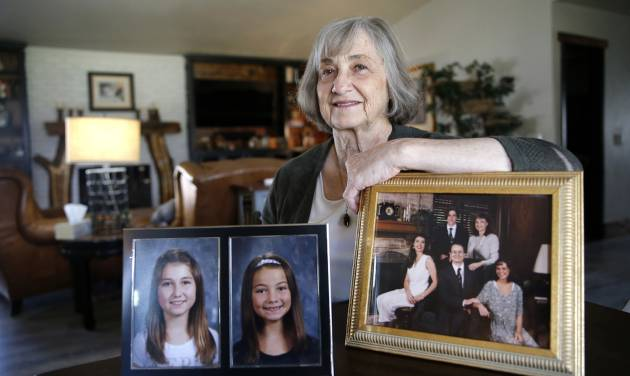 Helen Coffey holds pictures of her grandchildren, Aubrey and Alyssa, and a picture of her with...