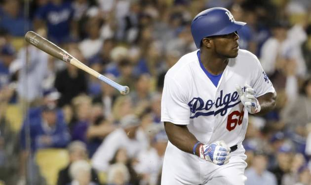 Puig, Grandal power Dodgers past Mets 8-2 and into 1st place