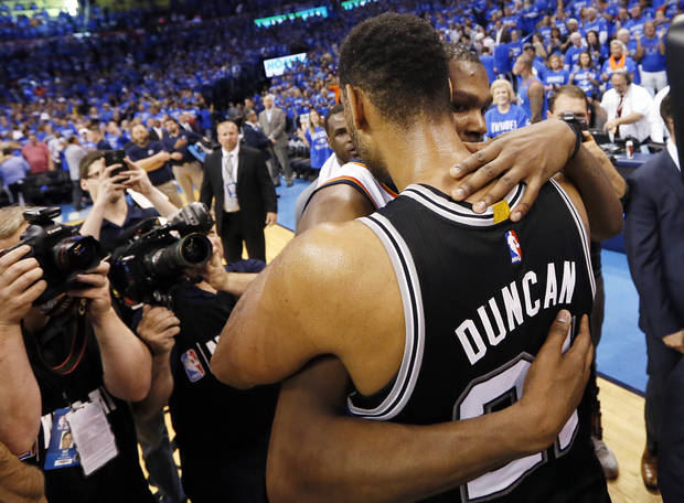 Oklahoma City's Kevin Durant (35) and San Antonio's Tim Duncan (21) hug after Game 6 of the Western Conference semifinals between the Oklahoma City Thunder and the San Antonio Spurs in the NBA playoffs at Chesapeake Energy Arena in Oklahoma City, Thursday, May 12, 2016. Oklahoma City won 113-99. Photo by Nate Billings, The Oklahoman