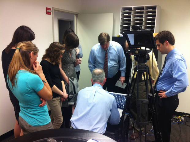 Chris Casteel shows reporters from the Washington Examiner some video clips.