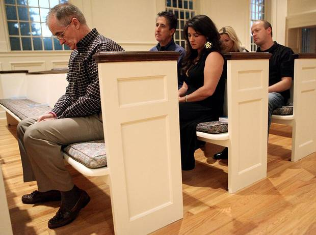 TIM FINDLEY: Jack Werner (left) along with Tim and Jenny Findley (second row) and Brian Maughan and his girlfriend Misty Garrett listen to a memorial service for Cheyenne Wolf at First Unitarian Church in Oklahoma City on Thursday, September 2, 2010. Photo by John Clanton, The Oklahoman ORG XMIT: KOD