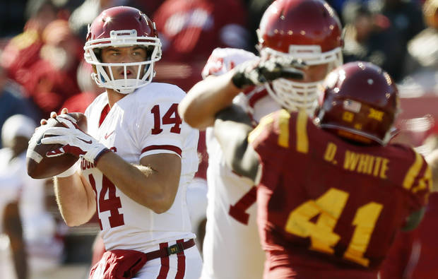 Oklahoma's Cody Thomas (14) looks to pass during a college football game between the University of Oklahoma Sooners (OU) and the Iowa State Cyclones (ISU) at Jack Trice Stadium in Ames, Iowa, Saturday, Nov. 1, 2014. Photo by Nate Billings, The Oklahoman