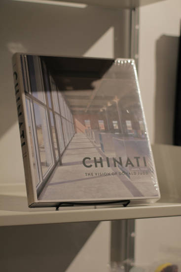 <p>A book about the Chinati Foundation sits on the shelves inside the Marfa Book Company on Sunday March 13, 2016 in Marfa, Texas. [Photo by Matt Carney, for LOOKatOKC]</p>