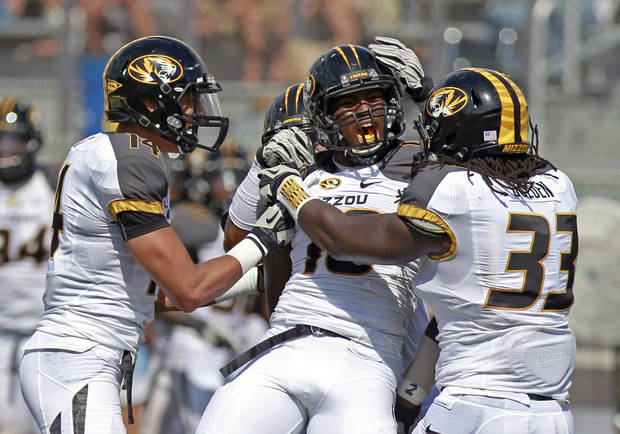 Missouri's Kentrell Brothers celebrates with teammates Jaleel Clark (14) and Markus Golden after making a tackle on Central Florida's Rannell Hall on a kickoff return during the second half of an NCAA college football game,  Saturday, Sept. 29, 2012, in Orlando, Fla. Missouri won 21-16.(AP Photo/John Raoux)