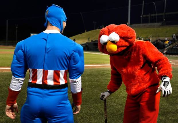 Captain America, Assistant Coach Ryan Connolly gives Elmo, Taylor Alspaugh, some batting advice during University of Oklahoma's baseball's  ALS Awareness Halloween Game at L. Dale Mitchell Park in Norman, Okla. , Thursday, Oct. 24, 2013. Photo by Sarah Phipps, The Oklahoman