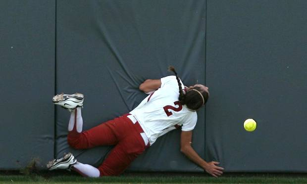 TU / COLLEGE SOFTBALL: Oklahoma's Brianna Turang hits the wall as she chases a ball in the outfield during the Sooners' game against Tulsa during the NCAA Softball Regional at the OU Softball Complex on the University of Oklahoma campus in Norman, Okla., on Sunday, May 22, 2011. The Sooners lost the first game to the Golden Hurricane 4-3 in 9 innings. Photo by John Clanton, The Oklahoman ORG XMIT: KOD