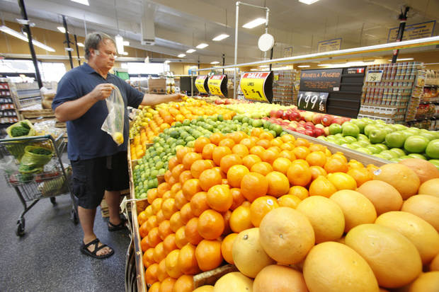 Richard Magann picks out fresh fruits at the new Sunflower Farmers Market grocery store in Oklahoma City, OK, Tuesday, Aug. 30, 2011. By Paul Hellstern, The Oklahoman