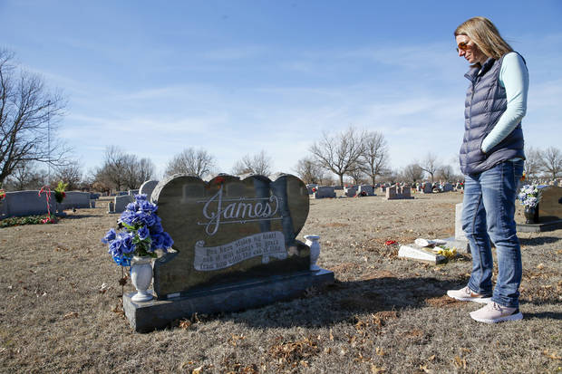 "Jennell James looks at the gravesite for her father, Darrell ""Jack""€ James, Saturday, Feb. 1, 2020, in Marlow, Okla. [Nate Billings/The Oklahoman]"
