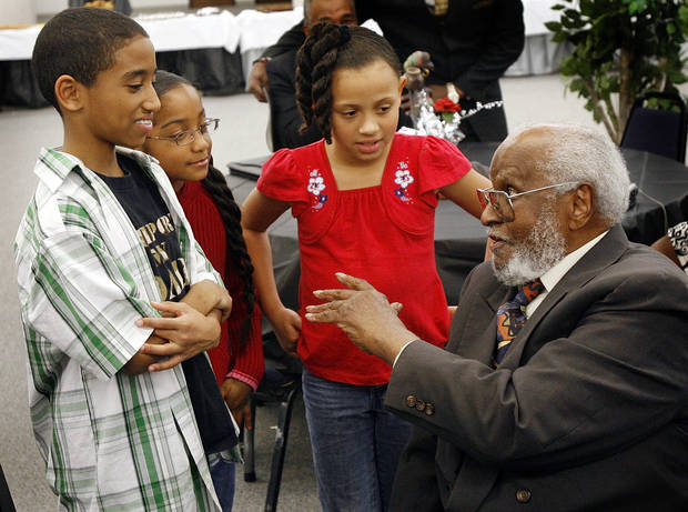 WESS YOUNG, Tulsa race riot survivor Wess H. Young, 90, talks to, from right, Drake Perry, 10, Dru Perry, 6, and Amber Holt, 8, during a reception by the Northeast Church of Christ at Langston University's Oklahoma City campus honoring the survivors of the Tulsa race riot, Friday, Feb. 23, 2007. By Nate Billings, The Oklahoman  ORG XMIT: KOD