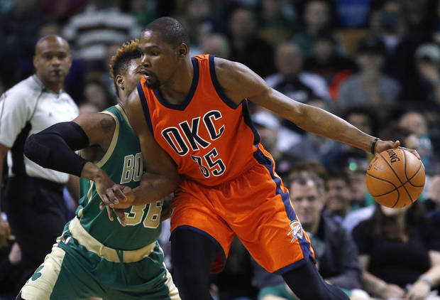 Oklahoma City Thunder's Kevin Durant (35) looks to move on Boston Celtics' Marcus Smart (36) during the first quarter of an NBA basketball game in Boston, Wednesday, March 16, 2016. The Thunder won 130-109. (AP Photo/Michael Dwyer)