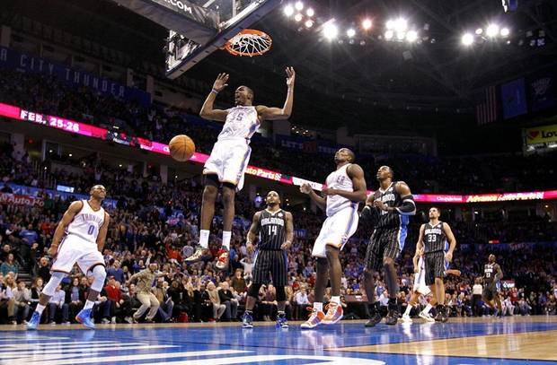 Kevin Durant (35) celebrates a basket  during the opening day NBA basketball game between the Oklahoma CIty Thunder and the Orlando Magic at Chesapeake Energy Arena in Oklahoma City, Sunday, Dec. 25, 2011. Photo by Sarah Phipps, The Oklahoman