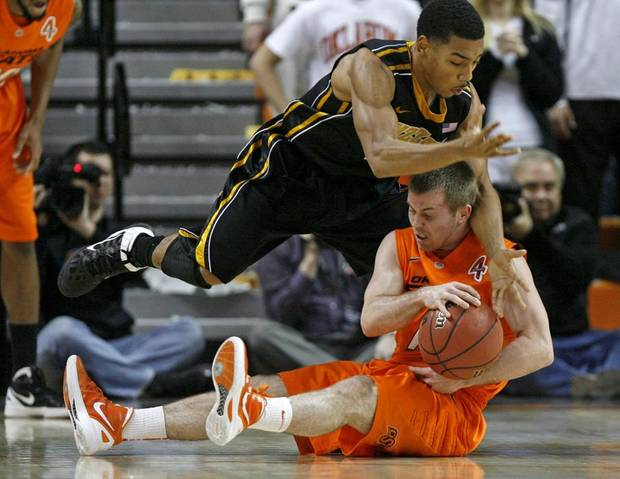 Missouri's Phil Pressey (1) and Oklahoma State's Keiton Page (12) fight for the ball during an NCAA college basketball game between the Oklahoma State University Cowboys (OSU) and the Missouri Tigers (MU) at Gallagher-Iba Arena in Stillwater, Okla., Wednesday, Jan. 25, 2012. Photo by Bryan Terry, The Oklahoman