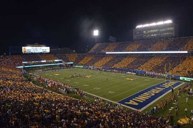 The West Virginia fans striped Milan Puskar Stadium with alternate blue and gold Saturday night during the OU-WVU game. (AP Photo)