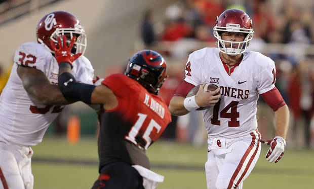 Oklahoma's Cody Thomas (14) runs during a college football game between the University of Oklahoma Sooners (OU) and the Texas Tech Red Raiders at Jones AT&T Stadium in Lubbock, Texas, Saturday, November 15, 2014.  Photo by Bryan Terry, The Oklahoman