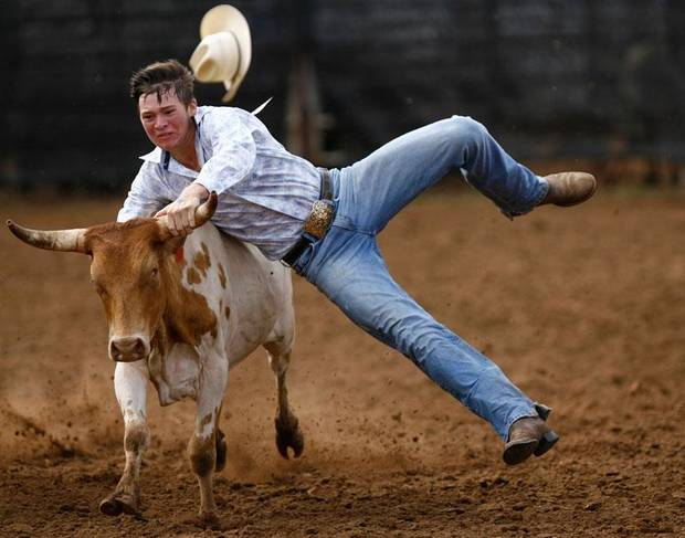 William Heinen of Jennings, Louisiana, jumps off his horse onto a steer in steer wrestling. The International Finals Youth Rodeo took place in Shawnee, Oklahoma, on Friday June 16, 2010. Photo by Mitchell Alcala, The Oklahoman