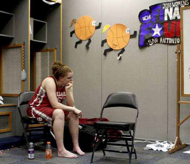 UNIVERSITY OF OKLAHOMA / WOMEN'S COLLEGE BASKETBALL / WOMEN'S NCAA TOURNAMENT: OU's Joanna McFarland sits in the locker room after Oklahoma's loss against Stanford in the Final Four of the NCAA women's  basketball tournament at the Alamodome in San Antonio, Texas., on Sunday, April 4, 2010.    Photo by Bryan Terry, The Oklahoman ORG XMIT: KOD