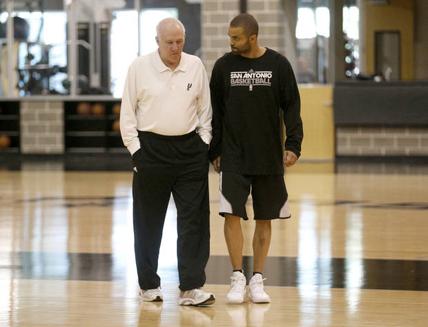 San Antonio's Tony Parker (9) talks with head coach Gregg Popovich before talking  to the media before the Spurs' practice at their facility in San Antonio, Tuesday, May 20, 2014. Photo by Sarah Phipps, The Oklahoman