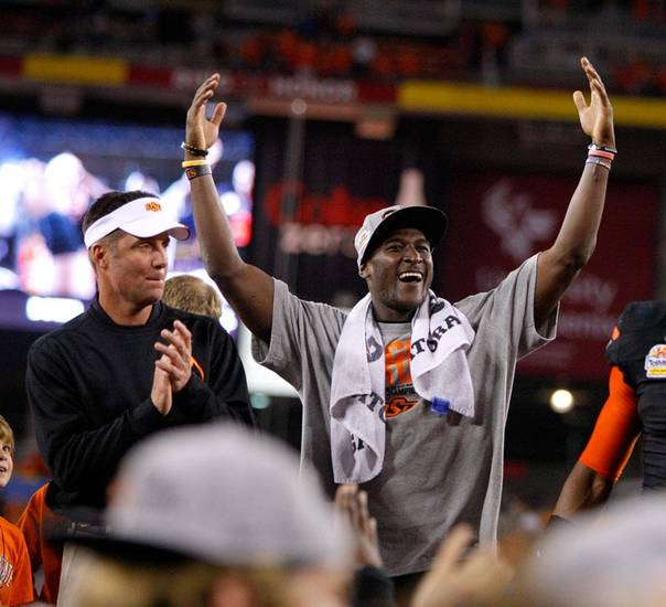 Oklahoma State's Justin Blackmon and coach Mike Gundy celebrate after winning the Fiesta Bowl between the Oklahoma State University Cowboys (OSU) and the Stanford Cardinals at the University of Phoenix Stadium in Glendale, Ariz., Tuesday, Jan. 3, 2012. Photo by Bryan Terry, The Oklahoman