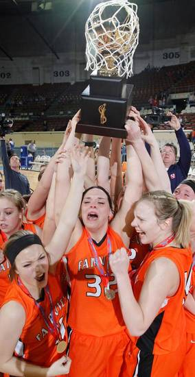 Led by Kori Fast (32) Fairview celebrates their win over Northeast during the 2A girls State Basketball Championship game between Northeast High School and Fairview High School at State Fair Arena on Saturday, March 10, 2012 in Oklahoma City, Okla.  Photo by Chris Landsberger, The Oklahoman