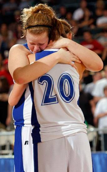 Cyril's Shelbi Stallings and Chelsea Reynolds (20) react to Cyril's loss after the girls'  Class B State Basketball finals, Saturday, March 7, 2009, at the State Fair Arena in Oklahoma City . PHOTO BY BRENDA O'BRIAN. THE OKLAHOMAN