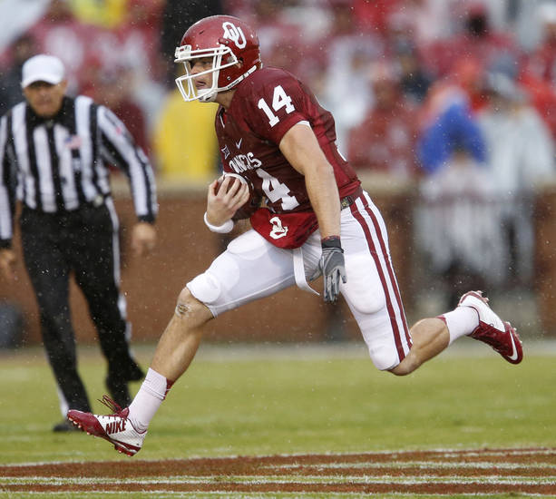 OU's Cody Thomas (14) runs during the college football game between the University of Oklahoma Sooners (OU) and the Kansas Jayhawks (KU) at Gaylord Family-Oklahoma Memorial Stadium in Norman, Okla. on Saturday, Nov. 22, 2014.  Photo by Bryan Terry, The Oklahoman