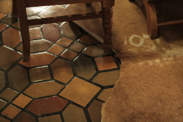 <p>The tiling on the floor of the Hotel Paisano lobby is seen on Sunday March 13, 2016 in Marfa, Texas. [Photo by Matt Carney, for LOOKatOKC]</p>
