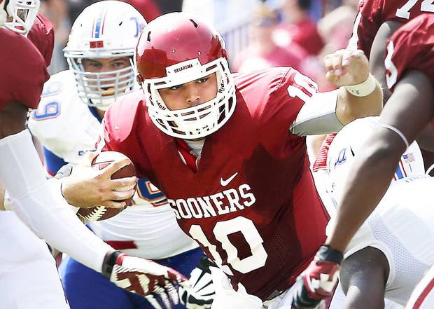 Oklahoma's Blake Bell (10) carries  the ball during the second half of a college football game between the University of Oklahoma Sooners (OU) and the Tulsa Golden Hurricane (TU) at Gaylord Family-Oklahoma Memorial Stadium in Norman, Okla., on Saturday, Sept. 14, 2013. Photo by Steve Sisney, The Oklahoman