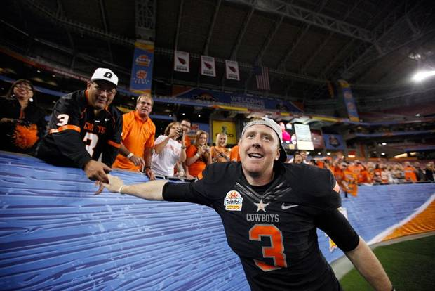 Oklahoma State's Brandon Weeden (3) celebrates with fans following the Fiesta Bowl between the Oklahoma State University Cowboys (OSU) and the Stanford Cardinals at the University of Phoenix Stadium in Glendale, Ariz., Tuesday, Jan. 3, 2012. Photo by Sarah Phipps, The Oklahoman