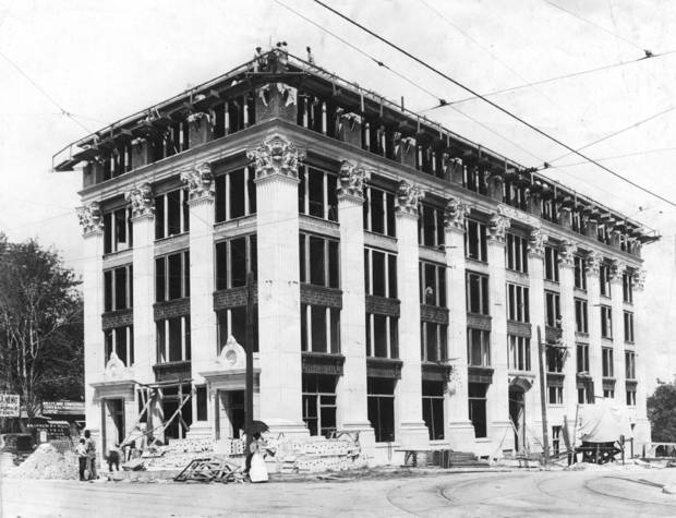 August 28, 1909 construction progress photo of the Oklahoma Publsihing Co. building at 500 N. Broadway. Exterior work still underway on the top floor. Passengers on the Capitol and Fairgrounds street cars had closeup inspections of the construction work as they rolled by. The Daily Oklahoman had a circulation of 35,040 when it moved into the building on October 10, 1909.