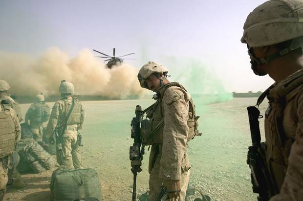 U.S Marine Cpl. Devin Cross, 22, of Richmond Ind., with Delta Company 1st Tank Battalion out of Twentynine Palms, Calif., waits to board a helicopter home as his company wraps up their deployment Sunday, July 17, 2011 at Combat Out Post Shir Ghazay in Helmand province, Afghanistan. (AP Photo/David Goldman)