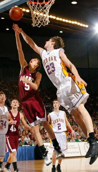 Garber's Dylan Postier (5) and Red Oak's Stuart Sullivan (23) jump for a rebound during the boys Class B State Basketball finals between Red Oak and Garber, Saturday, March 7, 2009, at the State Fair Arena in Oklahoma City . PHOTO BY BRENDA O'BRIAN, THE OKLAHOMAN