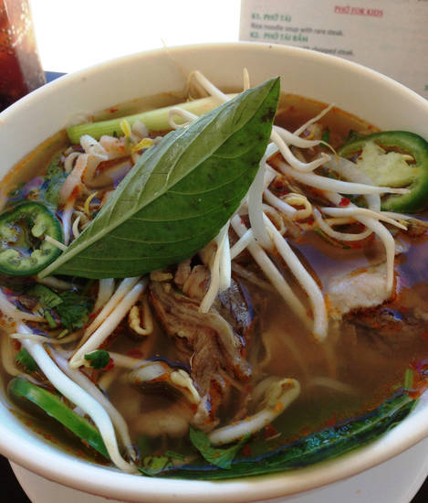 Pho Dac Biet includes rare beef, roasted brisket, tendon, tripe and all the pho trimmings.