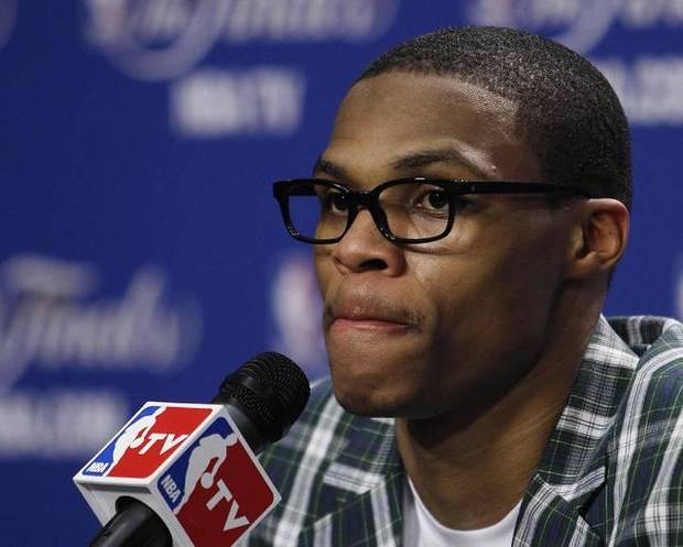 Oklahoma City Thunder point guard Russell Westbrook listens to a question during a news conference after Game 4 of the NBA finals basketball series against the Miami Heat, Wednesday, June 20, 2012, in Miami.