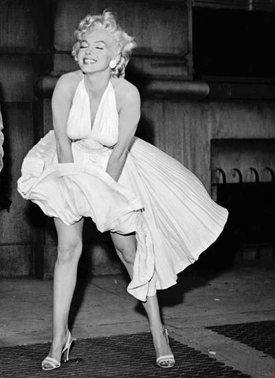 "Marilyn Monroe strikes a pose in her famous white halter dress she wore in ""The Seven Year Itch."""