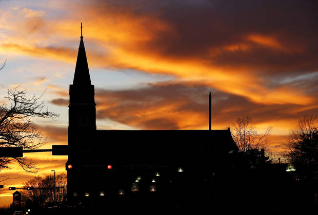 A sunset fills the dusk sky with color in downtown Oklahoma City  on Monday, March 16, 2015. In foreground is St. Joseph Old Cathedral at NW 4 and Harvey.  Photo by Jim Beckel, The Oklahoman