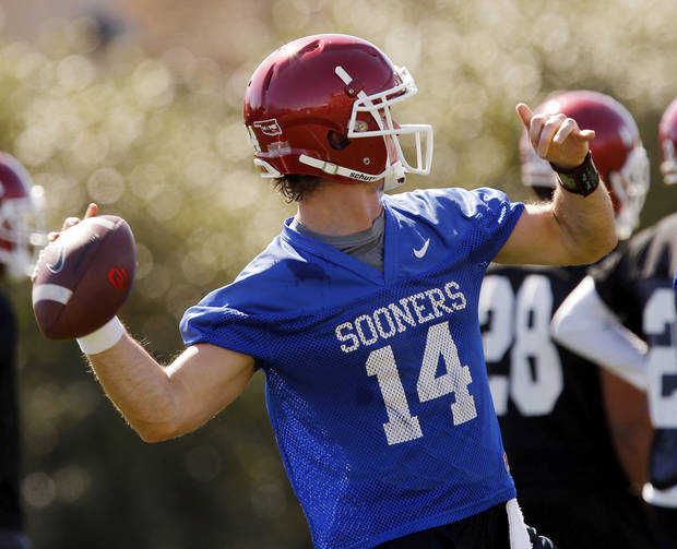 OU's Cody Thomas (14) passes during a drill at spring football practice for the University of Oklahoma Sooners in Norman, Okla., Monday, March 23, 2015. Photo by Nate Billings, The Oklahoman