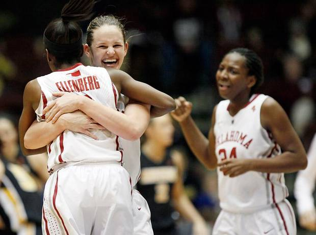 OU's Whitney Hand (25) and Aaryn Ellenberg (3) hug as Sharane Campbell (24) celebrates in the second half of the Big 12 tournament women's college basketball game between the University of Oklahoma Sooners and the University of Missouri Tigers at Municipal Auditorium in Kansas City, Mo., Thursday, March 8, 2012. OU won, 70-59. Photo by Nate Billings, The Oklahoman
