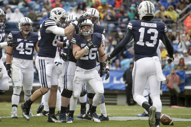 BYU running back Nate Carter (26) celebrates with teammates after scoring a touchdown against Savannah State during an NCAA college football Saturday, Nov. 22, 2014, in Provo, Utah. (AP Photo/The Daily Herald, Ian Maule) MANDATORY CREDIT