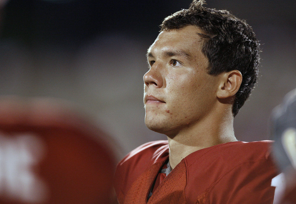 Photo - Oklahoma quarterback Sam Bradford on the sideline in the fourth quarter during the University of Oklahoma Sooners (OU) college football game against the University of North Texas Mean Green (UNT) at the Gaylord Family - Oklahoma Memorial Stadium, on Saturday, Sept. 1, 2007, in Norman, Okla.Bradford led the Sooners to a 79-10 victory in his first career game.
